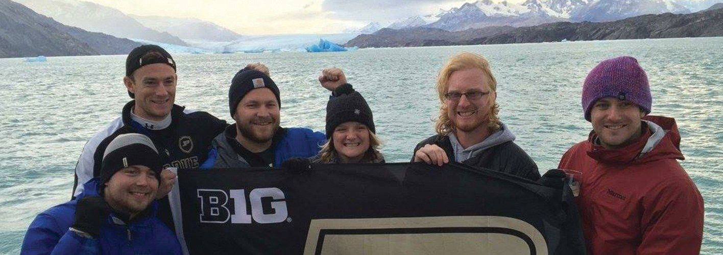 Tyler and fellow Purdue Boilermakers raise their school flag in Patagonia on a boat ride