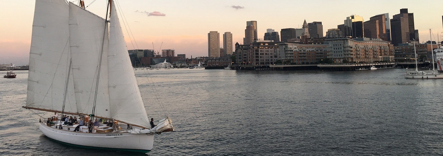 Boston Harbor with a sailboat going in to dock