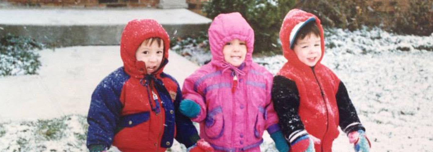three kids in snow gear