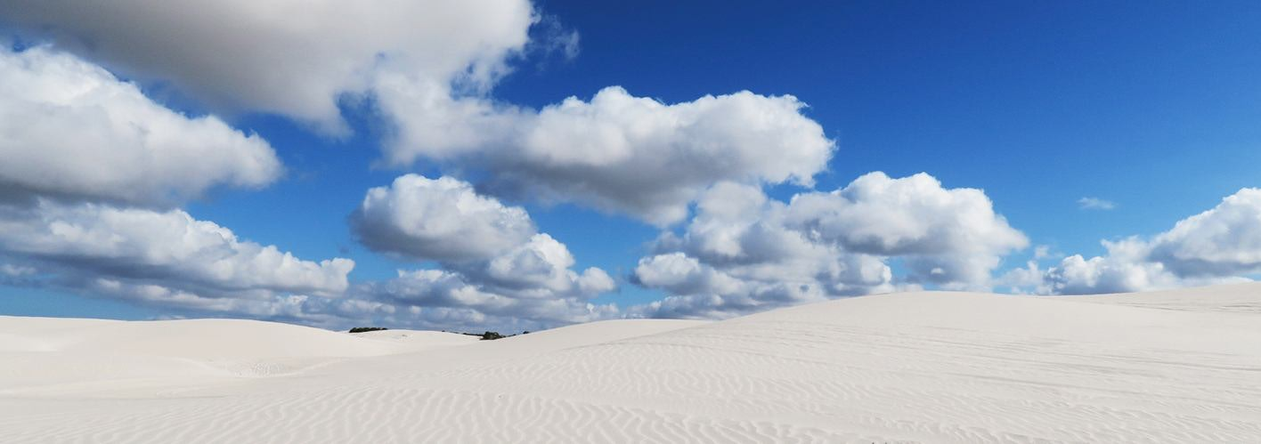 partially could blue sky over white sands