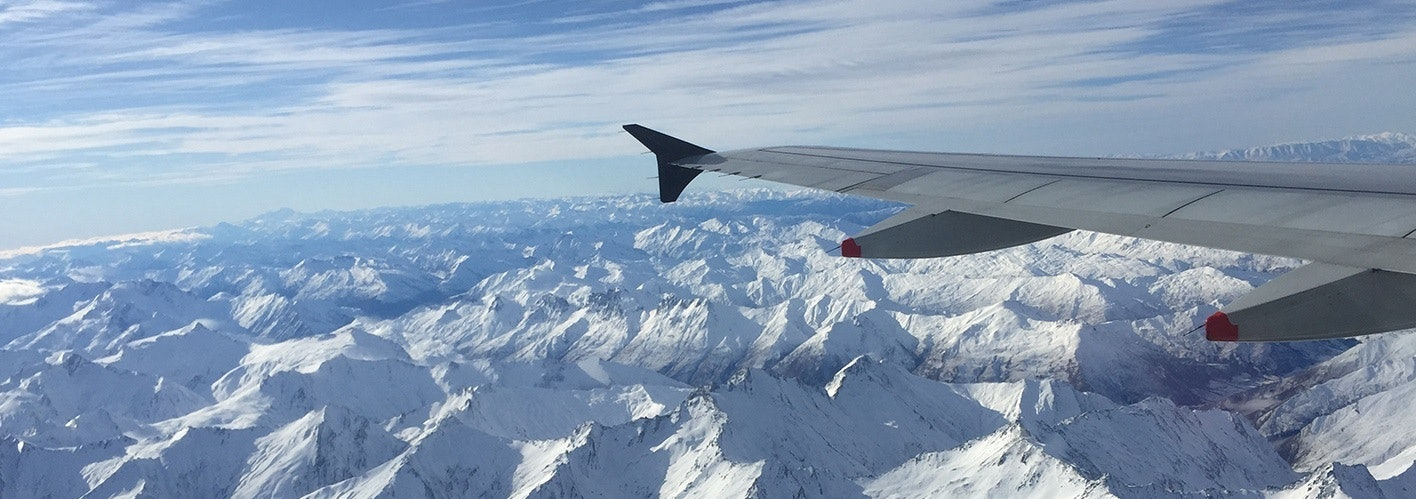 plane view over snowcovered mountains