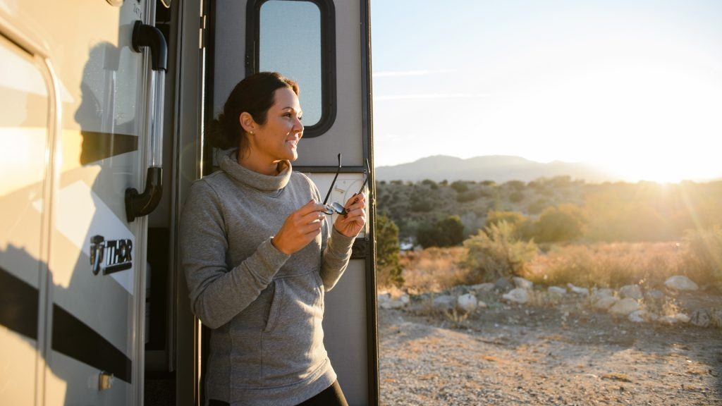 Millennial Woman Opening RV Door