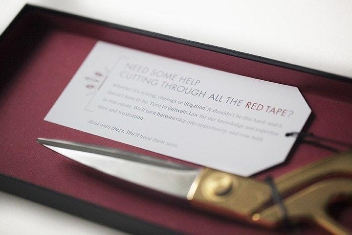 Gutwein law card and scissors in a box